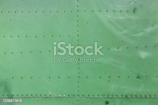 487808089 istock photo Old aircraft green painted aluminum texture with rivets. 1226371510