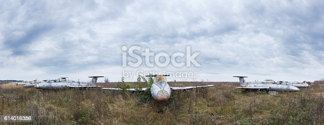 istock Old aircrafts at abandoned Airbase 614016386
