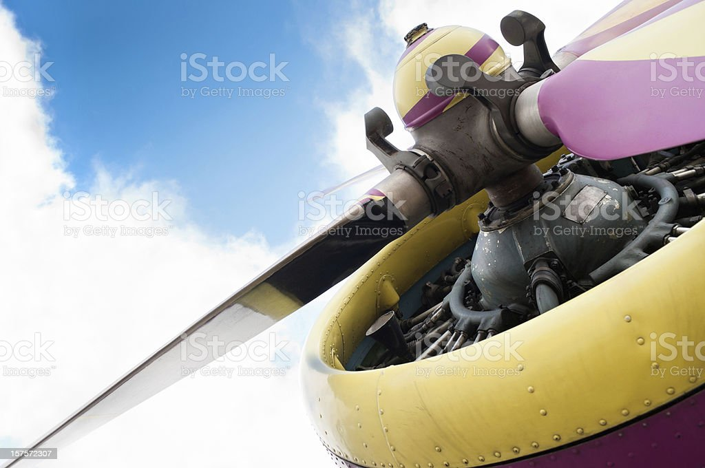 Old airplane propeller with engine shot from below. stock photo