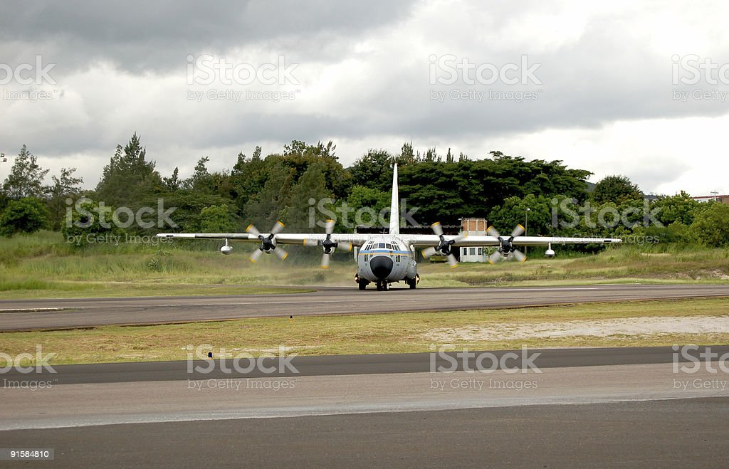 Old airplane taxiing stock photo