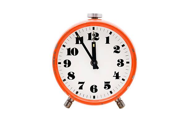Old alarm clock isolated stock photo