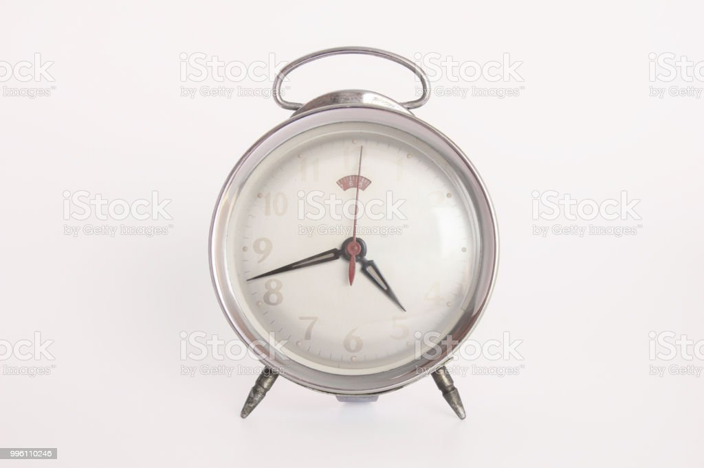 Old alarm clock on white background with clipping path. stock photo