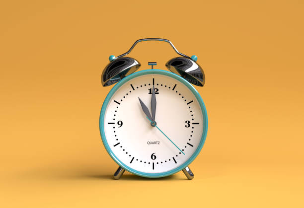 old alarm clock on yellow background - 11 o'clock - 3d illustration rendering stock photo