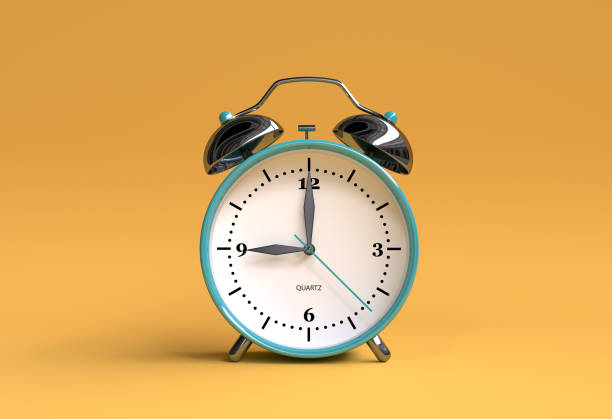 old alarm clock on yellow background - 9 o'clock - 3d illustration rendering - clock стоковые фото и изображения