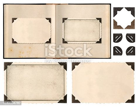 Old album book page with photo frames and corners isolated on white background