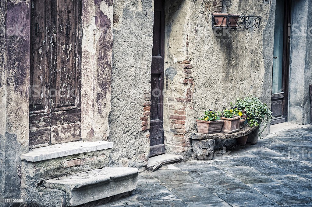 Old alley in a Tuscan town royalty-free stock photo