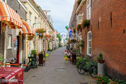 istock Old alley with flowers in the historic center of Delft, the Netherlands. 1137404325