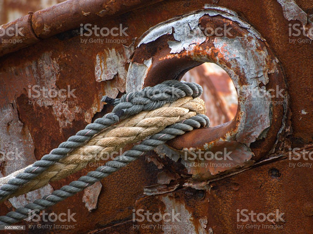 Old almost torn ship ropes on fisher boat wreck stock photo