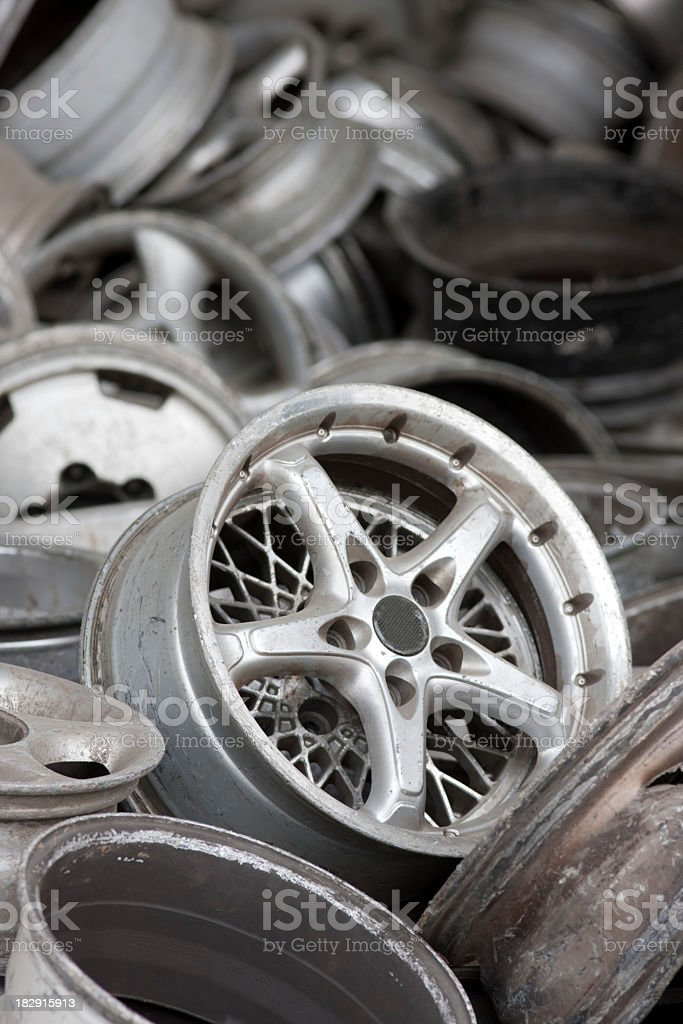 Old aluminum car wheel rims ready for recycling. royalty-free stock photo