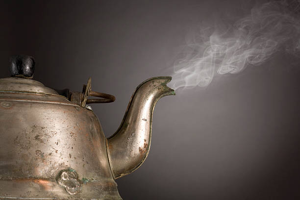 Old Aluminum Kettle steaming stock photo