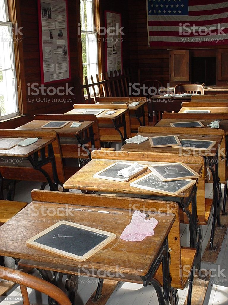 Old America school house with used chalk boards on each desk stock photo