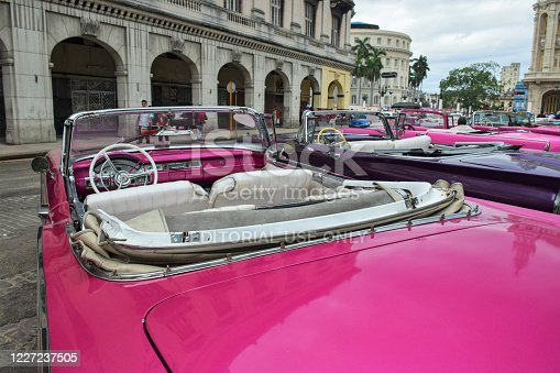 Havana, Cuba - 19th January, 2016: Classic American cabriolet vehicles parked on a street. The old-styled American vehicles from 50s are the ones of the most popular vehicles in Cuba.