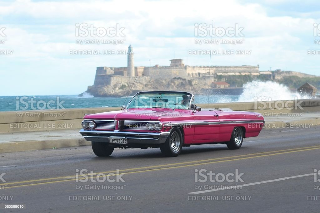 Old American car driving on the street stock photo