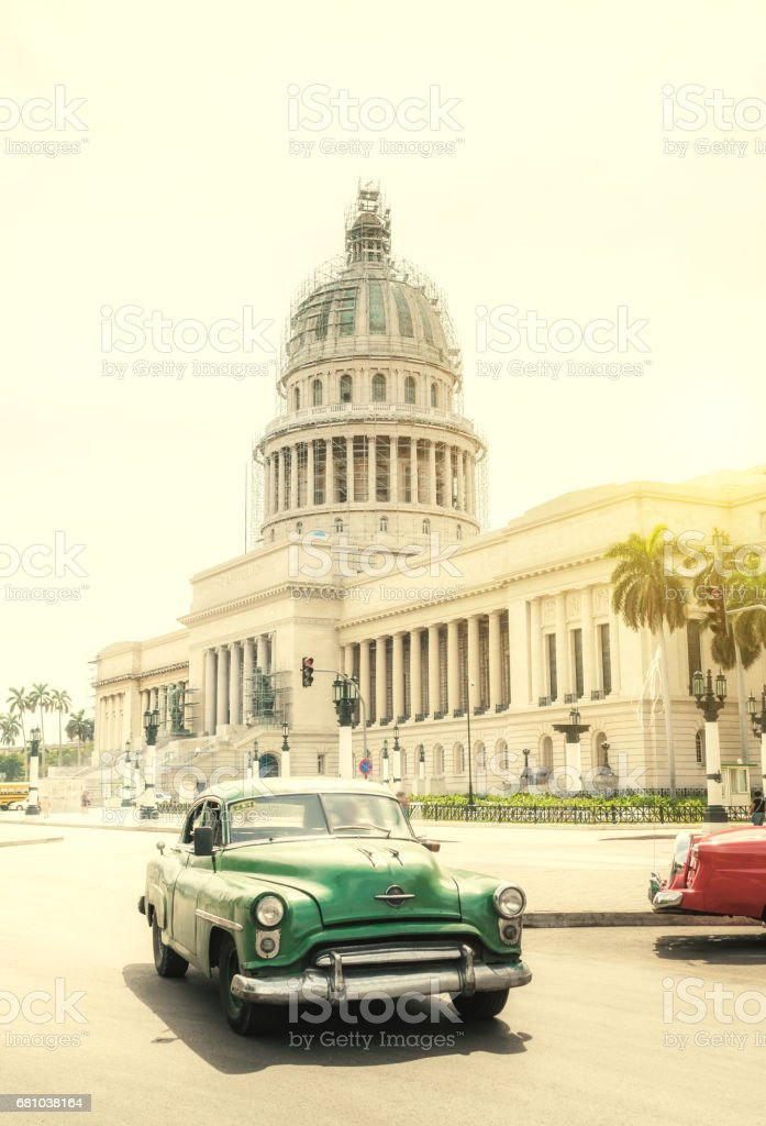 Old American car on Havana street in front of Capitol building royalty-free stock photo