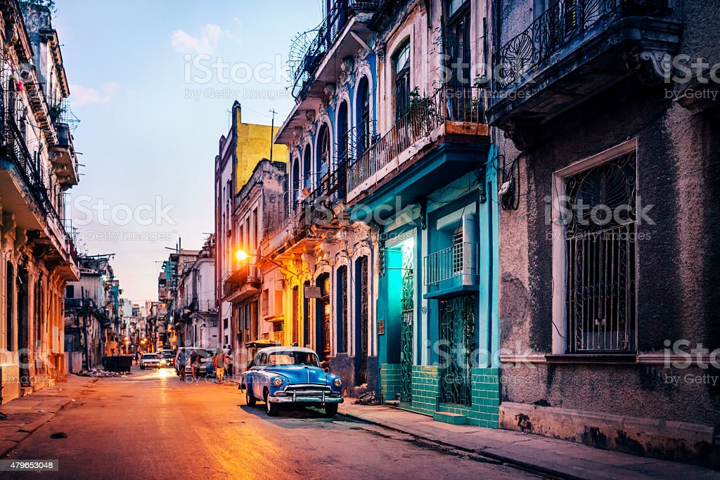 Old American car on street at dusk, Havana, Cuba stock photo