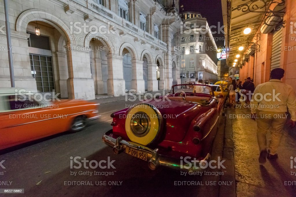 Old American car on street at Night, Havana, Cuba stock photo