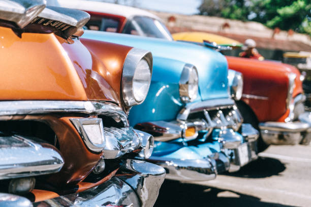 old american car parking on havana street, cuba - classic cars stock photos and pictures
