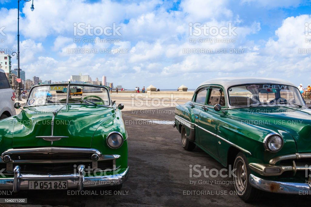 Old american cars on the road in Havana Malecon stock photo