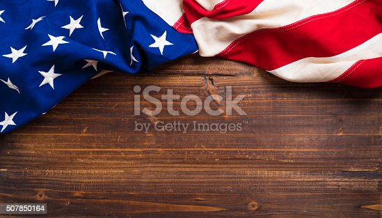 istock Old American Flag on wooden plank background 507850164