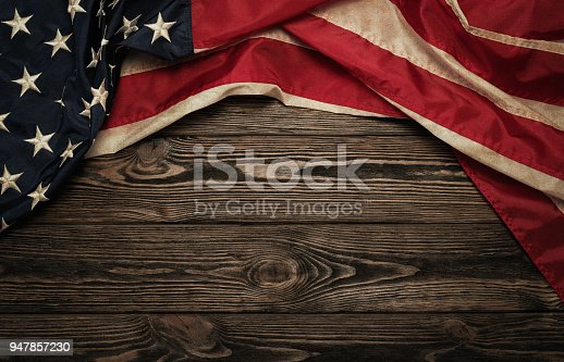 Old USA flag on wooden background with copy space