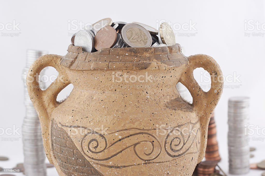 Old amphora with coins royalty-free stock photo