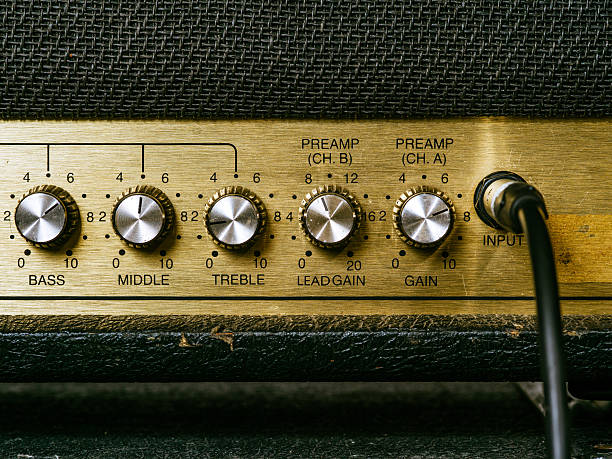 Old amplifier knobs Macro photo of a vintage electric guitar amplifier showing the knobs and input plug.. string instrument stock pictures, royalty-free photos & images