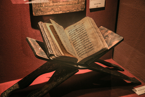 Old ancient quran (islam holy book) on red light. It's in the Muradiye complex, public and famous place in Tophane district in Bursa, Turkey