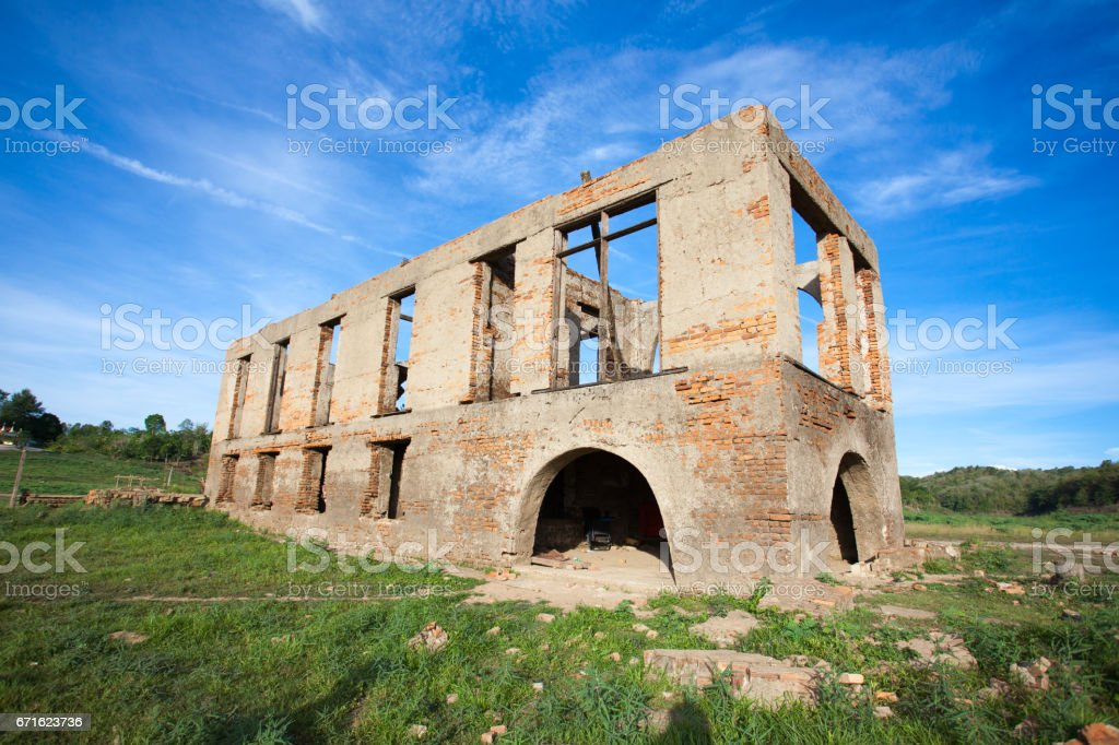 Old and Abandoned Building in a field with blue sky . . stock photo
