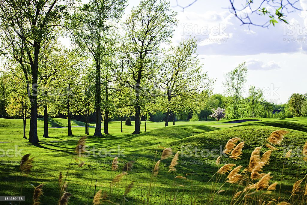 Old and beautiful bumpy golf course royalty-free stock photo
