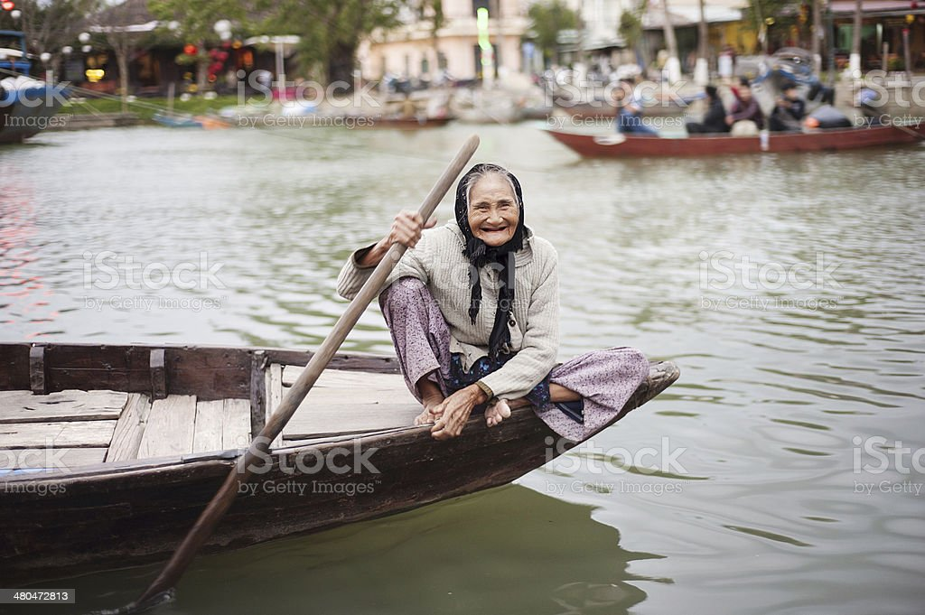 Old and beautiful smiling senior woman stock photo