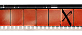 old and blank 16mm film movie strip with empty frames on white