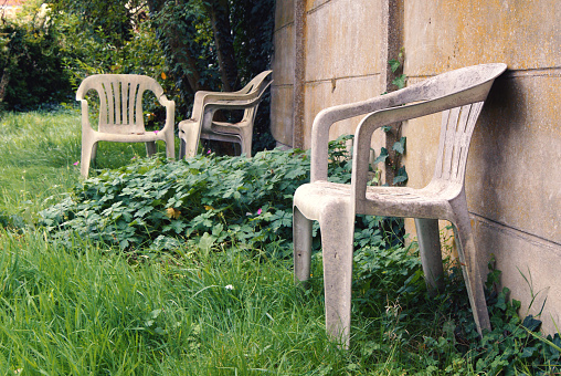 Old and damaged plastic chairs.