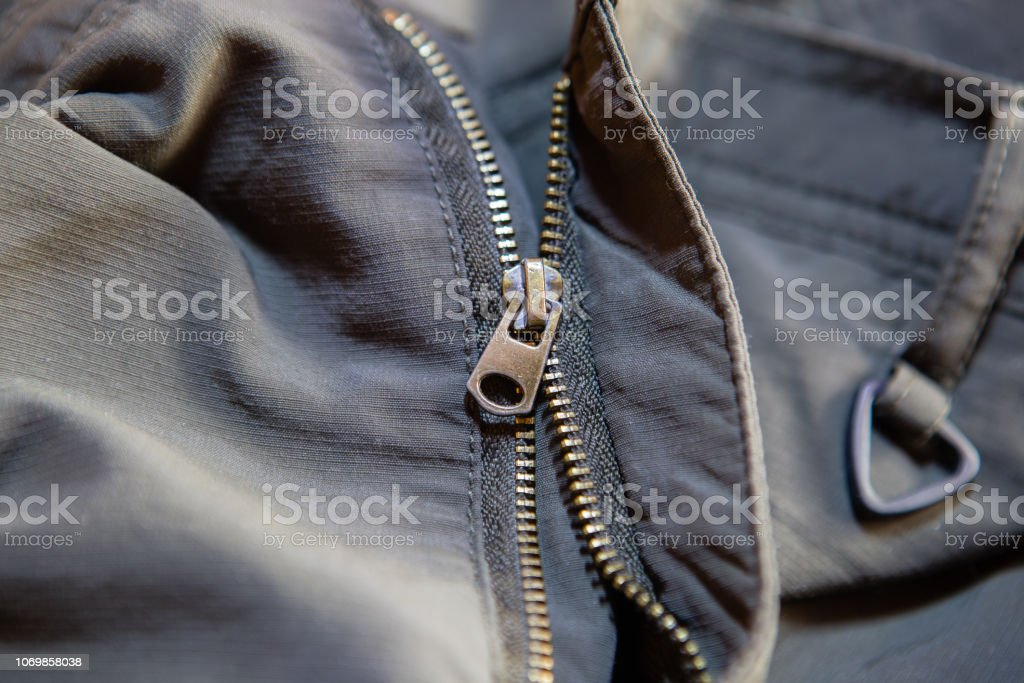 Old and damaged zipper stock photo