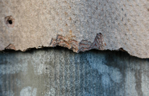 Old and dangerous asbestos roof. stock photo