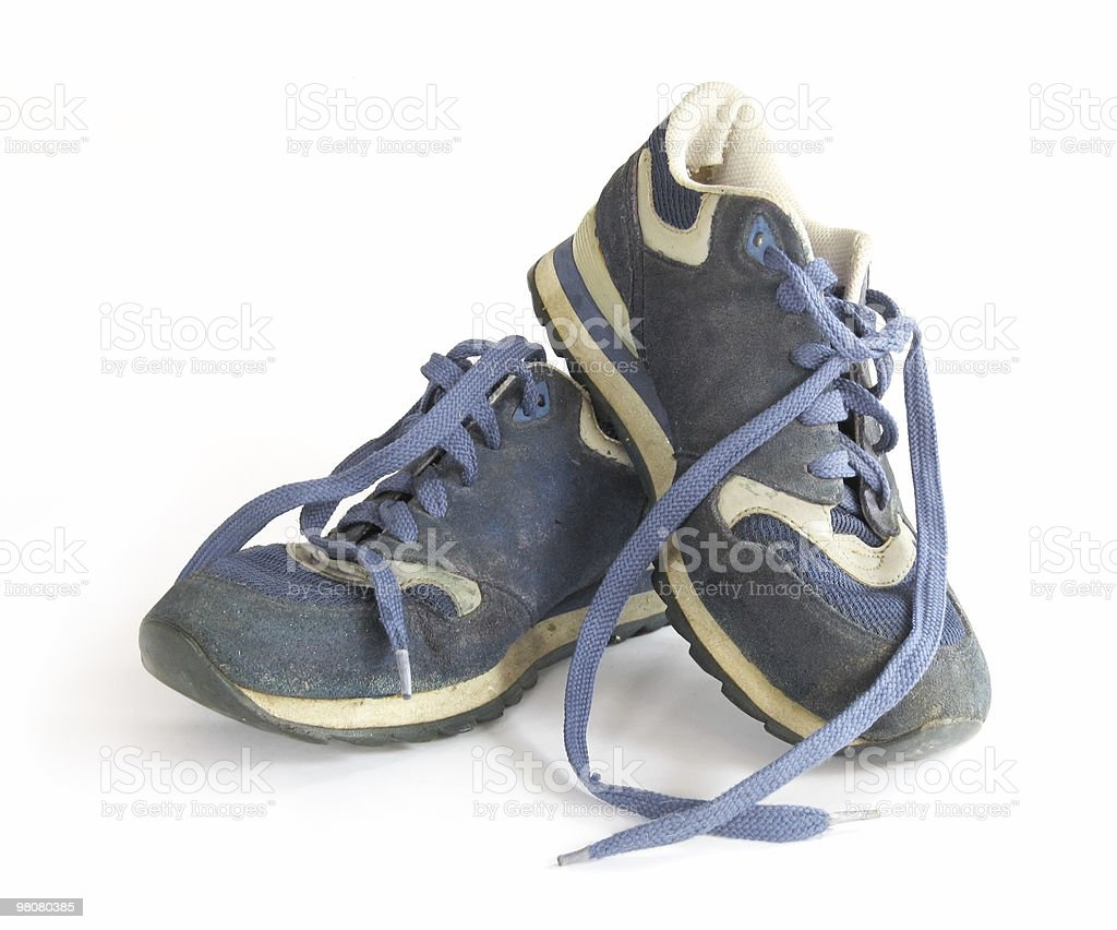 Old and Dirty Blue Sneakers royalty-free stock photo