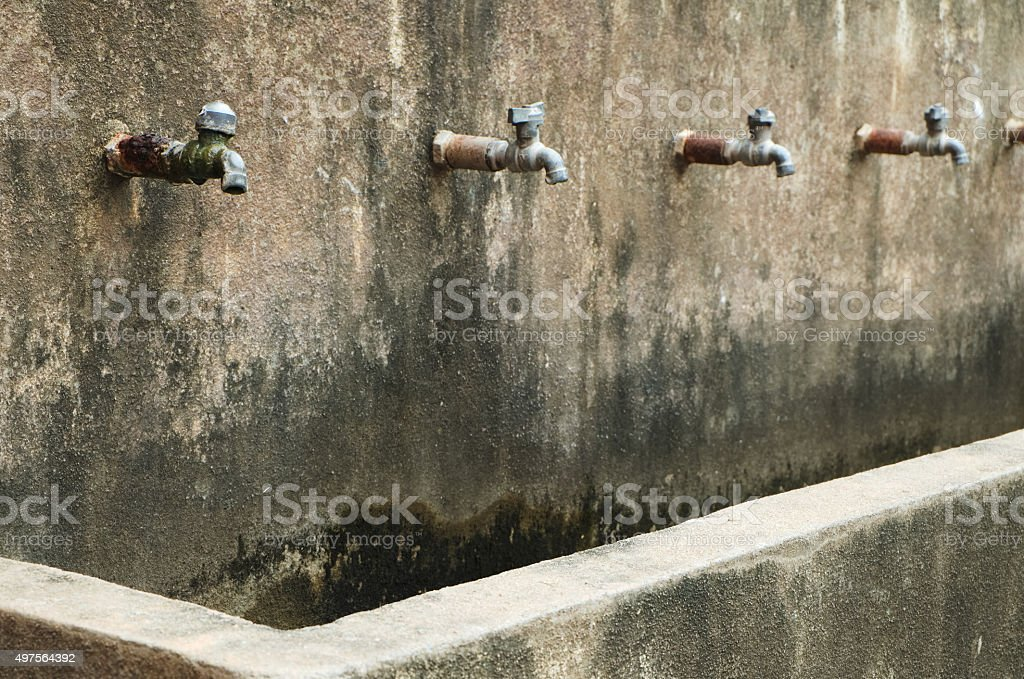 iStock & Old And Dirty Water Taps Selective Focus Stock Photo ...