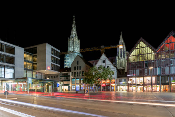 Old and Modern Architecture in Ulm, Germany Old and Modern Architecture in Ulm, Ulm Minster in the Background, Baden-Wurttemberg, Germany, HDR imaging ulm minster stock pictures, royalty-free photos & images