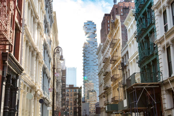 old and modern buildings in soho new york city - historic vs new stock photos and pictures
