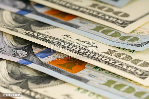 istock old and new 100 dollars banknotes background 1209666095