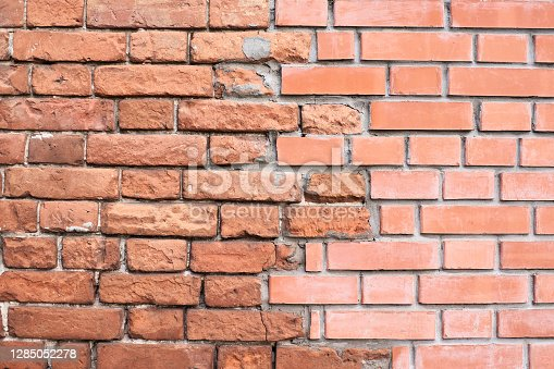istock Old and new brick wall 1285052278