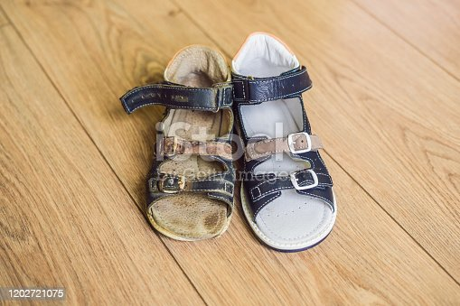 istock Old and new children's orthopedic shoes. Thomas Heel, arch support 1202721075