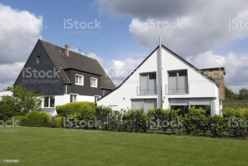 Old and new one family houses stock photo