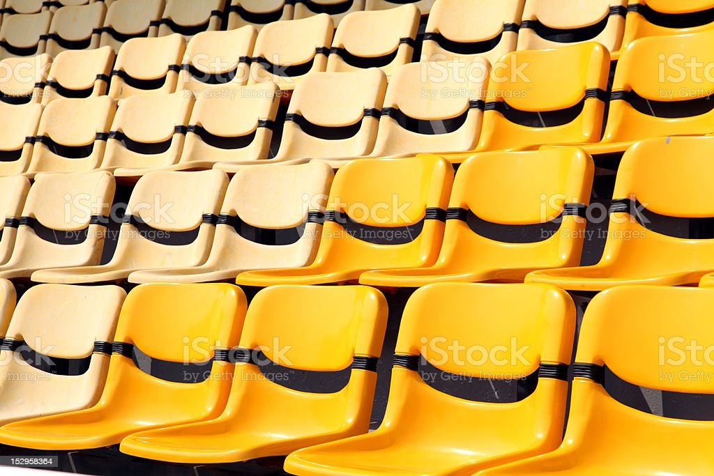 old and new yellow seat in stadium royalty-free stock photo