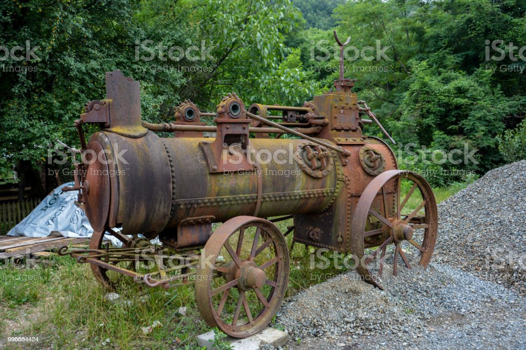 Old And Rustic Steam Train Or Tractor Used In Serbia In