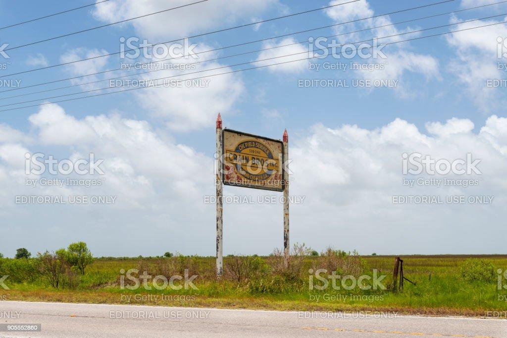 Old and rusty billboard along a roud near Lake Charles, Louisiana stock photo