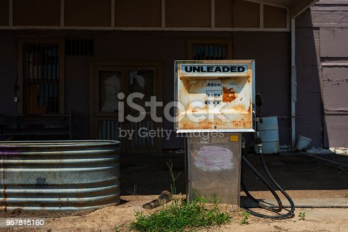 Old and rusty fuel pump in an abandoned gas station in the USA; Concept for fossil fuel, and global warming