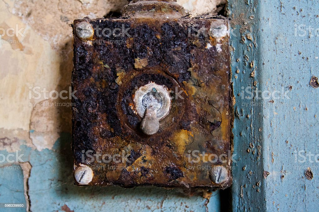 Old and rusty light switch royalty-free stock photo
