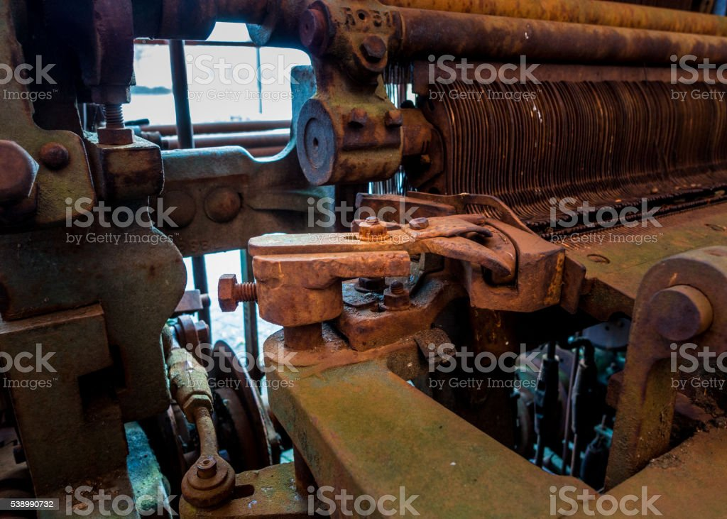 Old and rusty pinion gear of a machine in factory stock photo