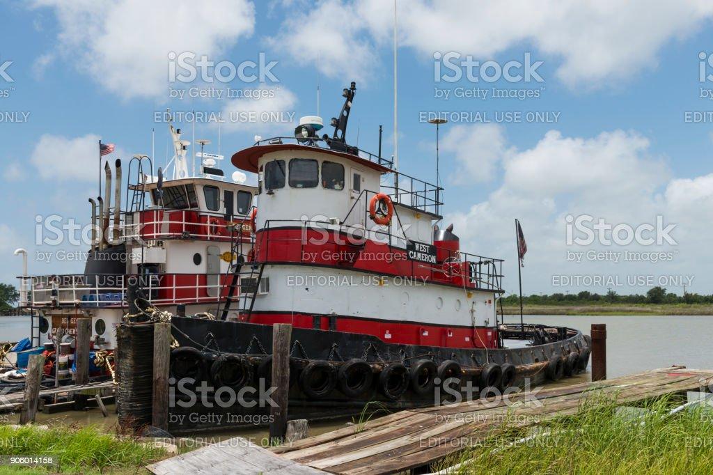 Old and rusty tugboat at Lake Charles, Louisiana, USA stock photo