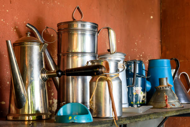 Old and used coffee pots on brazilian farm stock photo